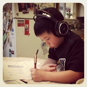 Evan practising letters